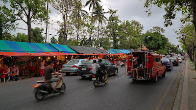Fruit stalls lining the outer fence of Nong Buak Hard park