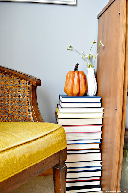 DIY book table with rustic pumpkin fall decor