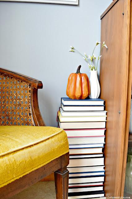 DIY book table with rustic pumpkin fall decor