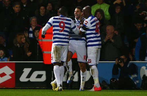 QPR player Adel Taarabt celebrates with his teammates after scoring his second goal against Fulham