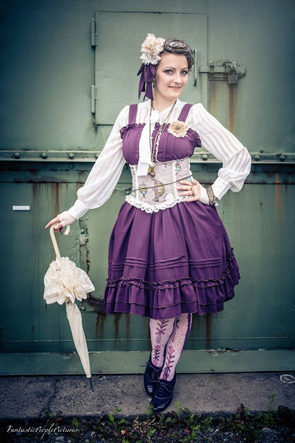 Colorful Steampunk Lolita purple dress, corset, blouse, fascinator and parasol.