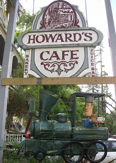 Sign for Howard's Cafe with locomotive art by Patrick Amiot and Brigitte Laurent, Occidental, California