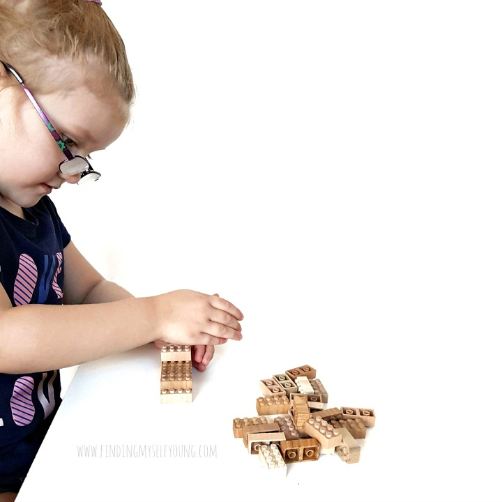 child building with mokulock building bricks