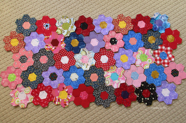 Turning hexies into flowers ready for a quilt ~ Threading My Way