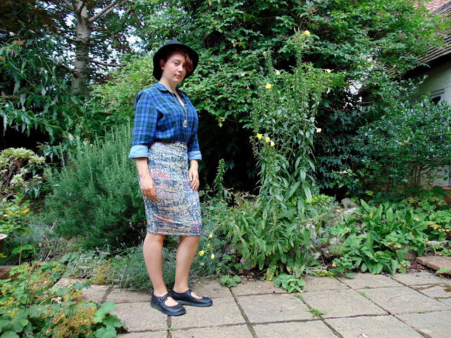 Blue check shirts and graffiti pencil skirt with Doc Martens and Trilby