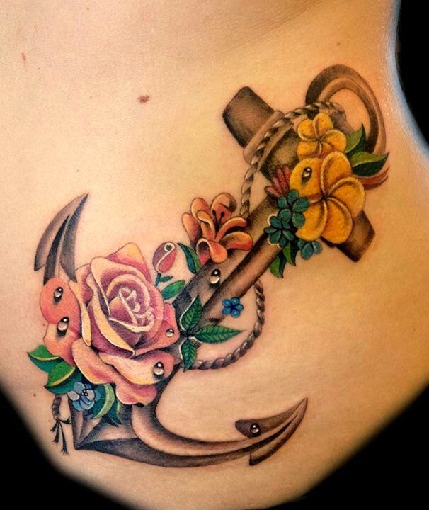 Lovely anchor with flowers tattoo.The dewdrops are absolutely amazing!