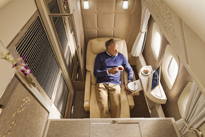 Source: Emirates. A fully-enclosed First Class private suite with the seat in the zero gravity position.