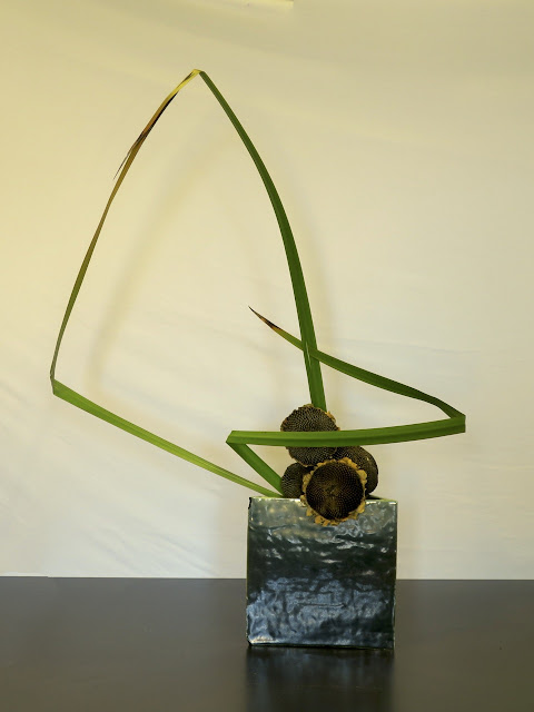 This Is My Work In Which I Have Made Triangles With Coastal Sword Sedge,  Used Five Dried Sunflower Heads For Their Circular Shape And Arranged Them  In An ...