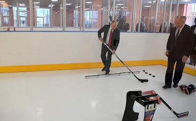 Vladimir Putin playing hockey at the new public Olympic Reserve hockey school.