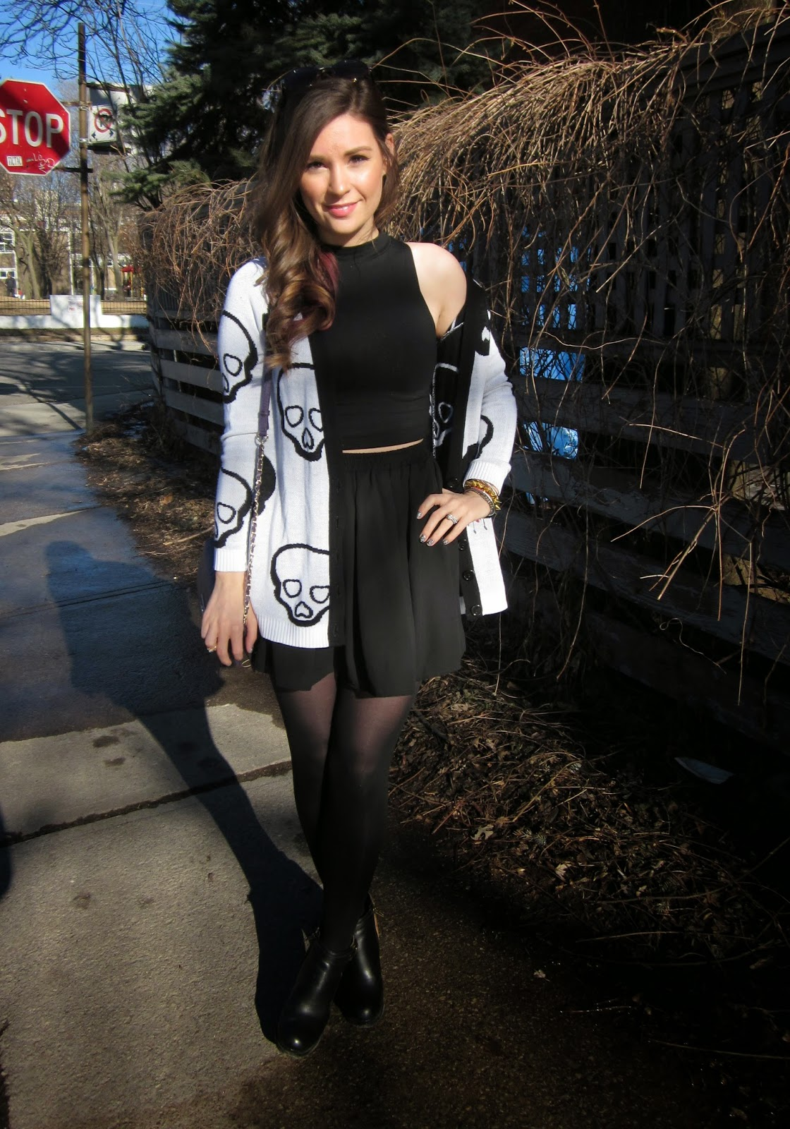 Black crop top, black skater skirt, skeleton print cardigan, black wedge boots