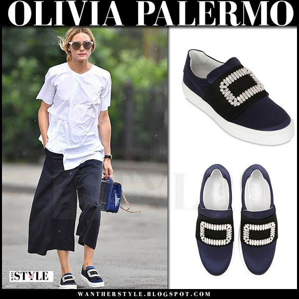 Olivia Palermo in white shirt, navy cropped pants and blue crystal embellished roger vizier sneaky viv slip on sneakers what she wore