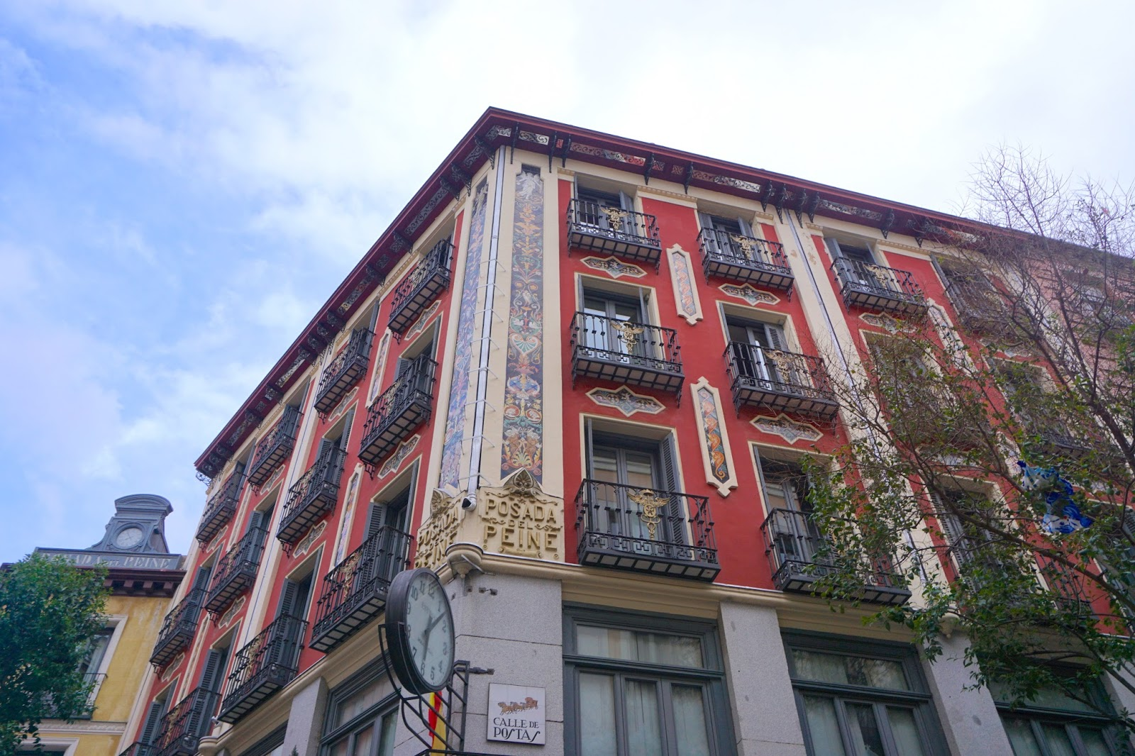 The intricate patterns and designs on a wall in Madrid above eye level