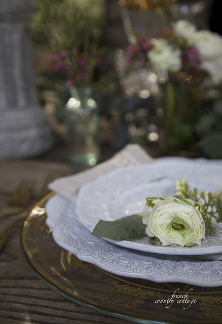 Close up of table set with china and ranunculus