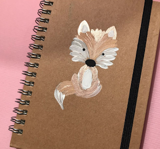 A cute Folky Fox helps decorate this plain notebook