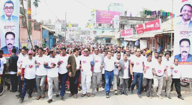 Jamalpur municipality's colorful rally on the occasion