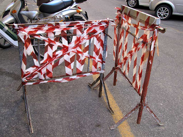 Red and white tape on barriers, via dell'Angiolo, Livorno