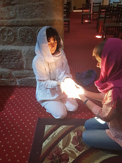 christina ritchie sharing the light in  an Egypt monastery
