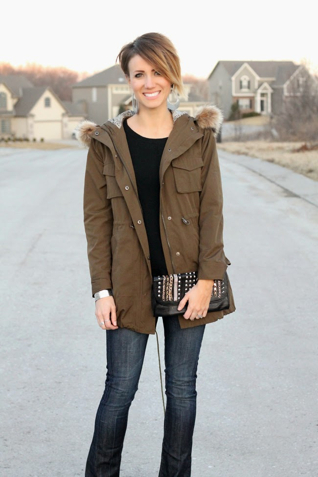 Military jacket, black tunic and boot cut jeans