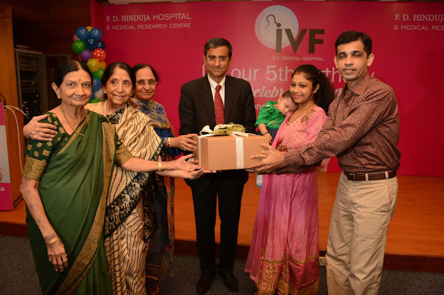 Pic 1 L to R- Dr. Kusum Zaveri, Dr. Indira Hinduja, Mr. Gautam Khanna, CEO along with India's first scientifically documented IVF child, Harsha Chawda with her family at P.D. Hin