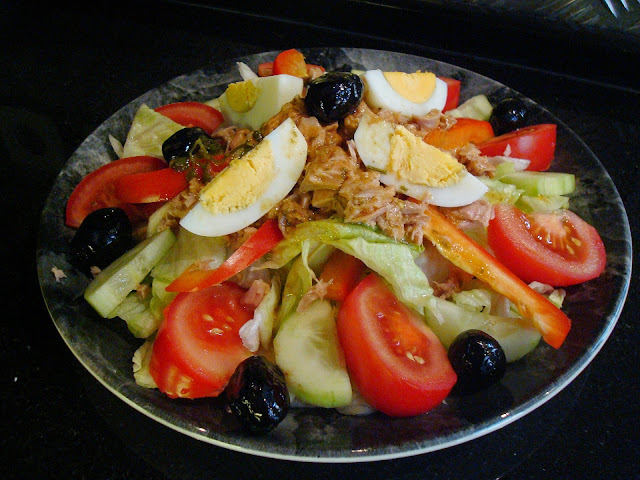 Huge Lettuce Salad with Tuna, Eggs, Tomatoes, Olives, and Peppers