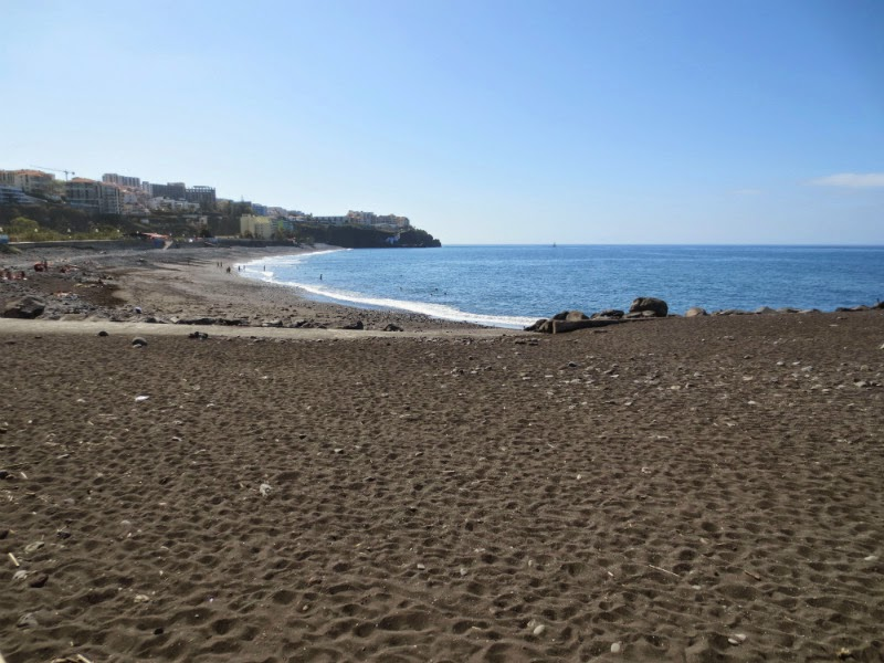 Praia Formosa with black sand and pebbles