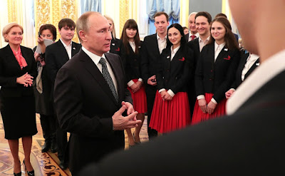 Putin and members of WorldSkills-Russia team.