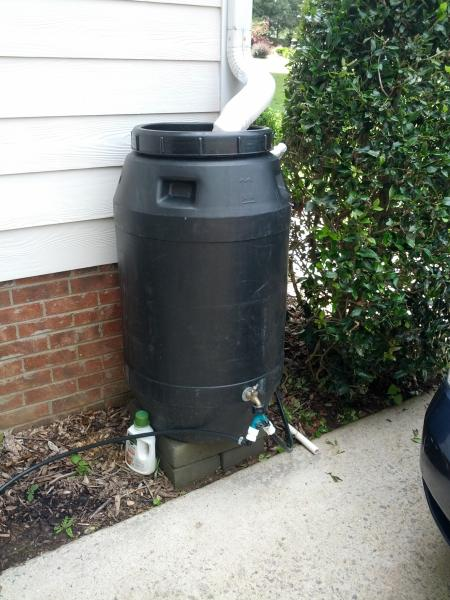 This Is The Barrel That Feeds Drip Irrigation For My Raised Beds Lucky Me There S A Drainage Gap In Driveway Tubing Fits