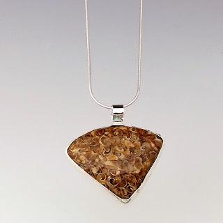 http://elunajewelry.com/gemstone-jewelry/brown-turritella-pendant-necklace/