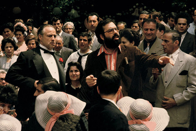 Marlon Brando with director Francis Ford Coppola in The Godfather movieloversreviews.filminspector.com