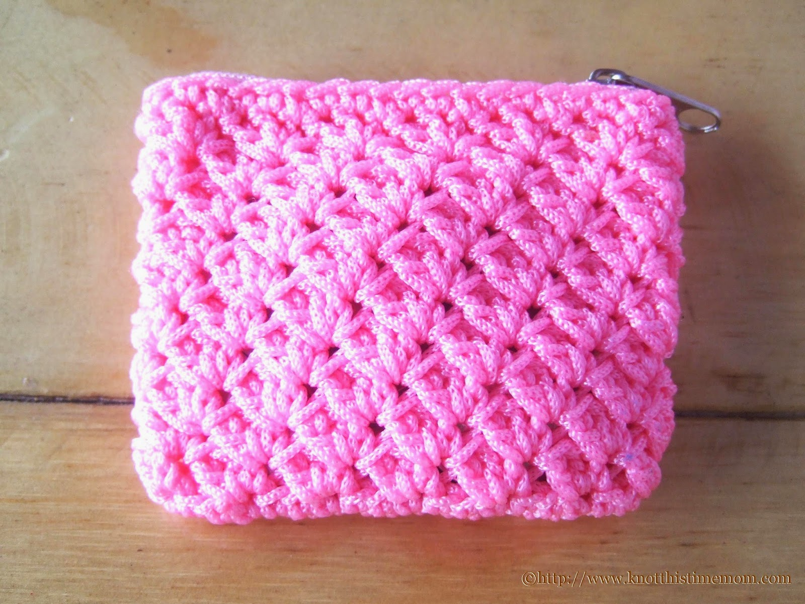 shell stitch coin purse made of pink tiny cord