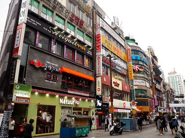 Colourful signs on building exteriors in Seomyeon, Busan, South Korea