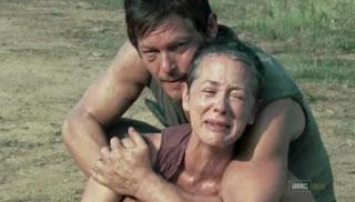 Daryl comforting Carol