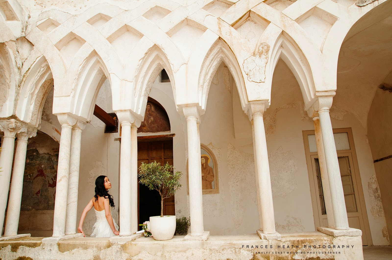 Bride in Hotel Convento cloisters
