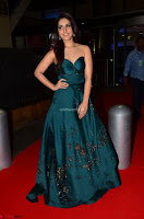 Raashi Khanna in Dark Green Sleeveless Strapless Deep neck Gown at 64th Jio Filmfare Awards South ~  Exclusive 035.JPG