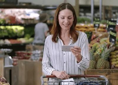 Woman Using Ring Video Doorbell