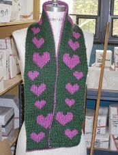 http://www.ravelry.com/patterns/library/trailing-hearts-double-knit-scarf