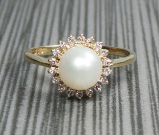 sun pearl engagement ring