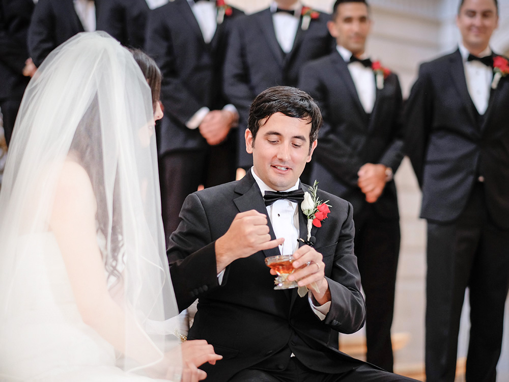 Persian Iranian wedding Groom feeds bride honey