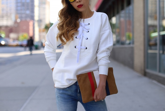Shein White Lace Up Front Sweatshirt, lace up top, clare v Supreme Flat Clutch , blank denim distressed jeans, christian louboutin so kate pumps, quay sunglasses, nyc street style