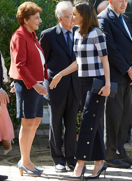 Queen Letizia wore BOSS Floriza Gingham Wool Blend Knit Top and Queen Letizia wore BOSS High Waist Wide Leg Pants at meeting