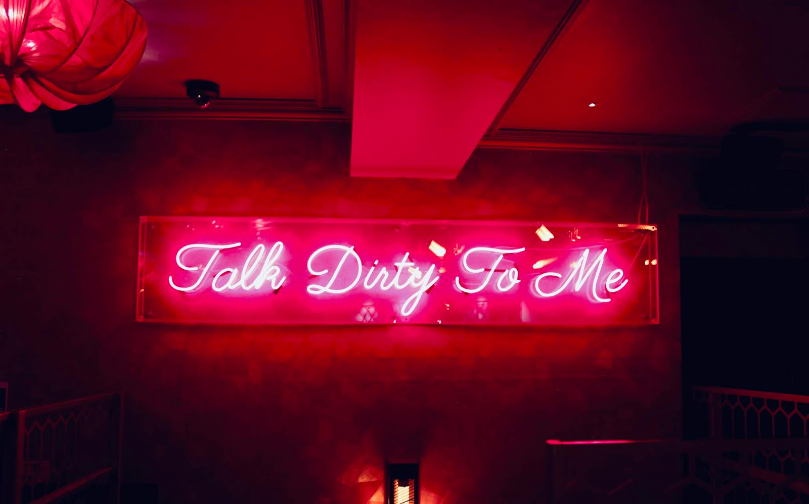 Neon 'talk dirty to me' sign in Dirty Martini