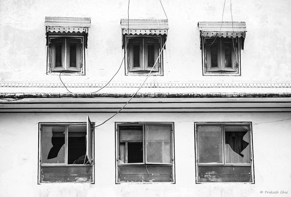 A Black and white Minimalist Photo of Broken windows at Diggi Palace Jaipur