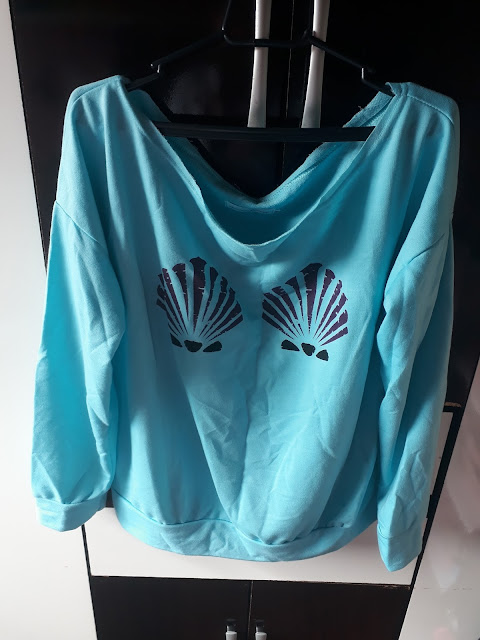 http://www.rosegal.com/sweatshirts-hoodies/long-sleeve-one-shoulder-shell-print-729690.html?lkid=88196