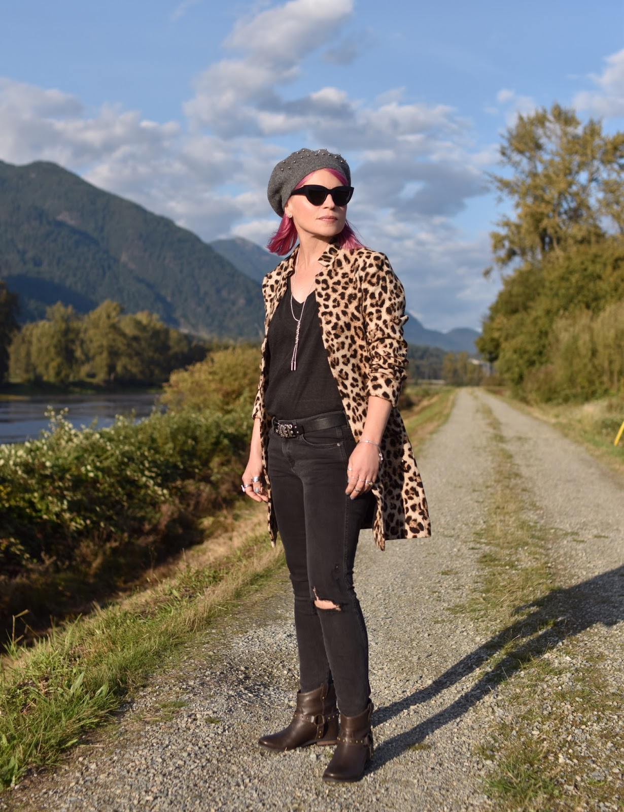 Monika Faulkner outfit inspiration - distressed black skinny jeans, leopard-patterned coat, hidden-wedge booties, beaded beret