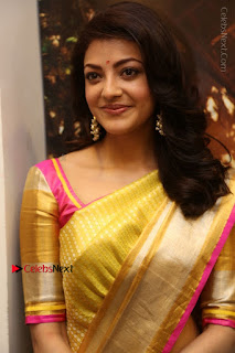 Actress Kajal Agarwal Stills in Golden Silk Saree at Trisha Sesigner Store Launch  0015.jpg