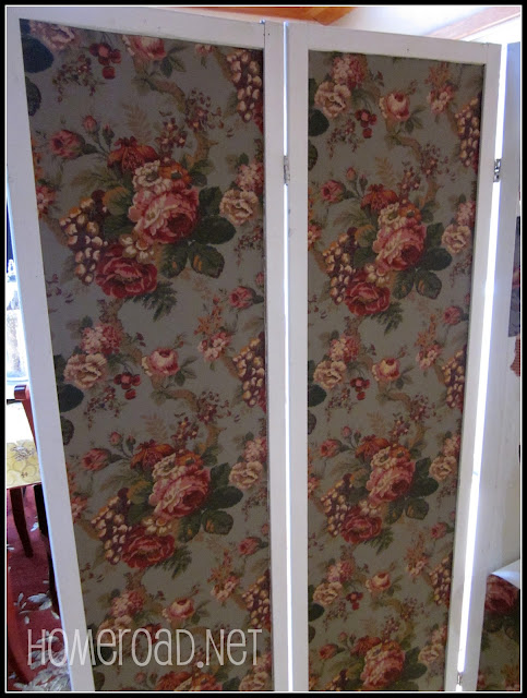 Green cabbage rose wallpaper on a room divider
