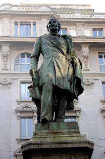 The monument to Carlo Cattaneo in Via Santa Margherita in Milan