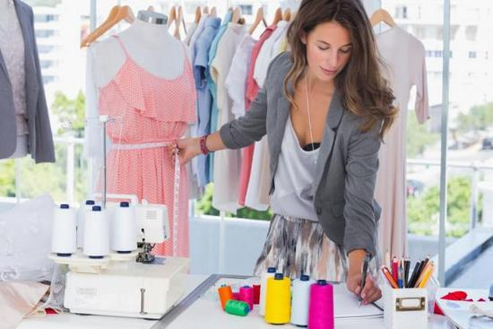 a fashion merchandising student creating a clothing piece