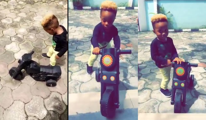 Olamide's cute son rides toy scooter with his dad
