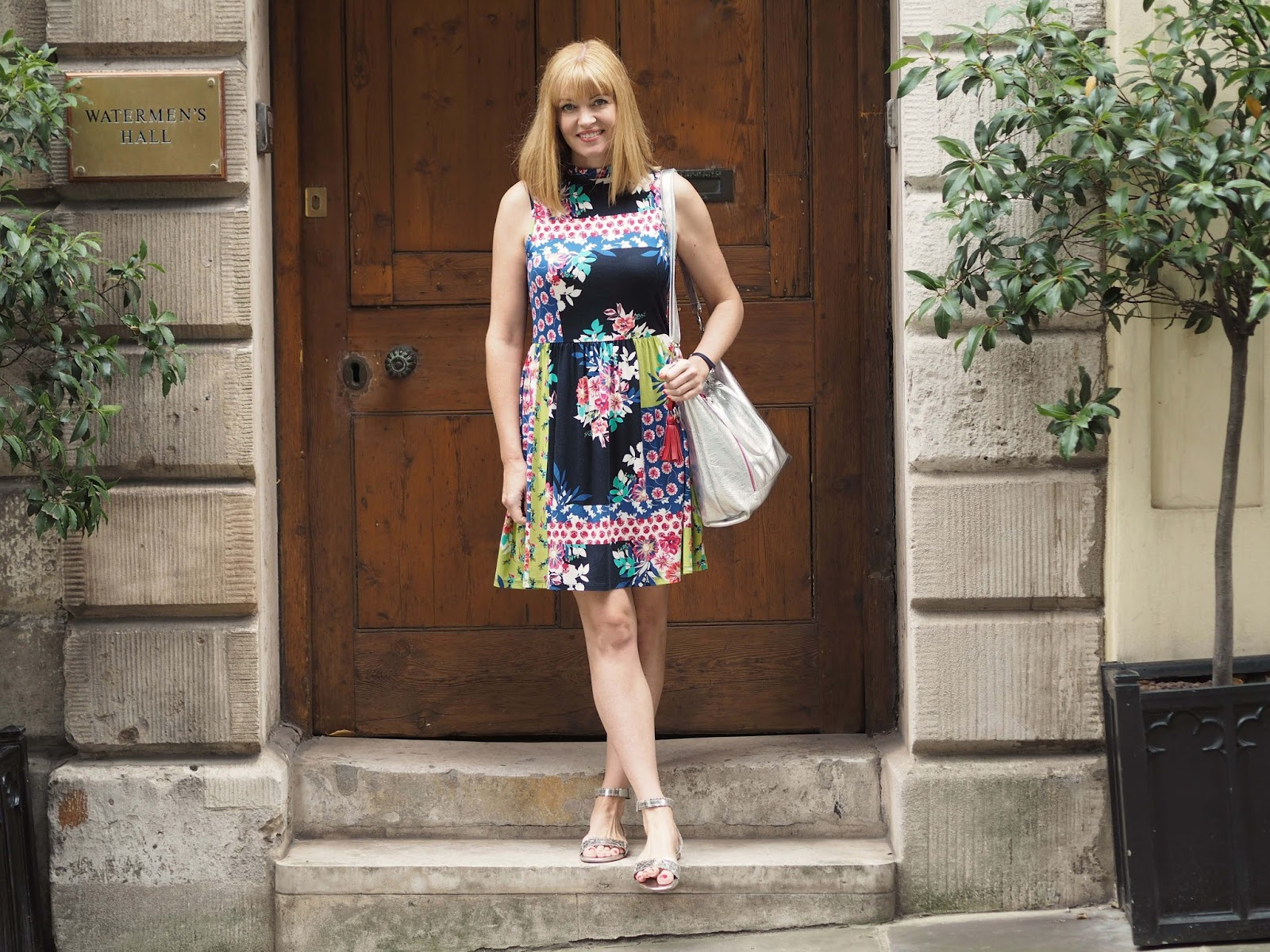 Multi-coloured floral dress with silver sandals and silver leather tote bag